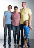 Elderly woman with her son and grandchildren. Elderly women with her son and grandchildren in the studio royalty free stock photography