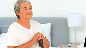 Elderly woman with her walking stick stock footage