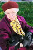 Elderly woman hold rabbit. On hand Royalty Free Stock Photos