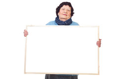 Elderly woman holding banner Royalty Free Stock Photos