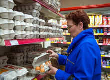 Elderly woman holding a box of eggs in her hands. Voronezh, Russia - April 27, 2017: Elderly woman holding a box of eggs in her hands stock photo