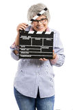 Elderly woman holding a clapboard Stock Photo