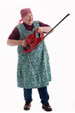 Elderly woman holding an electric garden saw 2. A lusty female senior with garden saw looks to viewer 2 stock photo
