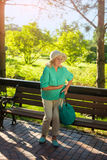 Elderly woman holding her stomach. Stock Images