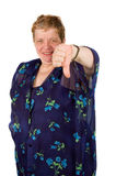 Elderly woman is holding her thumb down. (focus on hand royalty free stock photography