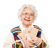 Elderly woman holding old envelops Stock Photos