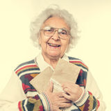Elderly woman holding old envelops Stock Photo