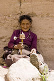 Elderly woman holding prayer wheel Stock Images