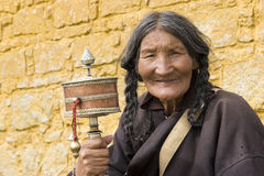 Elderly woman holding prayer wheel Royalty Free Stock Photo