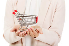 Elderly woman holding small trolley Royalty Free Stock Images