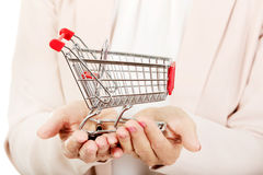 Elderly woman holding small trolley Stock Photo