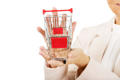 Elderly woman holding small trolley Stock Photography
