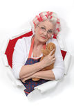Elderly woman holding teddy Royalty Free Stock Image