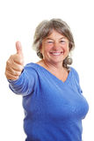 Elderly woman holding thumb up Royalty Free Stock Photography