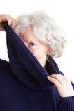 Elderly woman holding turtleneck Stock Photography