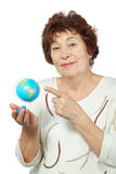 Elderly woman holds globe in her hand Royalty Free Stock Photo