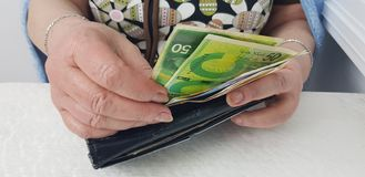 Elderly woman holds in hands israeli cash money royalty free stock photography