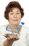 Elderly woman holds toy cart on her palm Royalty Free Stock Image