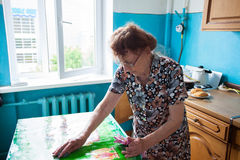 Elderly woman at home Royalty Free Stock Images