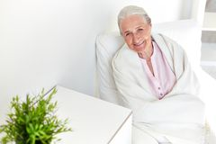 Elderly woman at home Stock Images