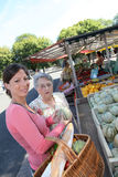 Elderly woman with homecarer at the market Royalty Free Stock Photos