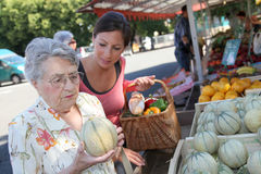 Elderly woman with homecarer at the market Royalty Free Stock Photo