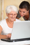 Elderly woman with homehelp Stock Photography