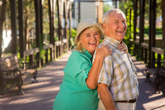 Elderly woman hugs man. Stock Image