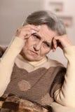 Elderly woman ill Royalty Free Stock Photos