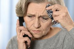 Elderly woman with ill throat Royalty Free Stock Image