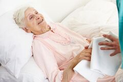 Free Elderly Woman Is Washed By Elderly Care Assistants Stock Image - 186943601