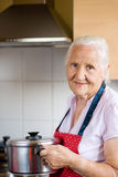 Elderly woman on the kitchen Royalty Free Stock Photos