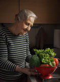 Elderly woman kitchen Stock Photo