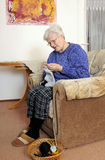 Elderly woman knitting Stock Photo