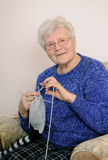 Elderly woman knitting Stock Photos