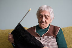 Elderly woman knitting at home Royalty Free Stock Photos