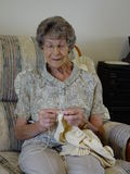 Elderly Woman Knitting Stock Images