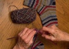 Elderly Woman Knitting Socks Stock Photography