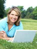 Elderly woman with laptop Royalty Free Stock Photography