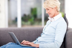 Elderly woman laptop Stock Photo