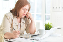 Elderly woman with a laptop Royalty Free Stock Photography