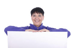 Elderly woman leaning across a white wall. Isolated Royalty Free Stock Image