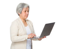 Elderly woman learn to use notebook Royalty Free Stock Images