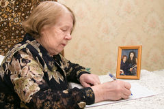 Elderly woman and letter royalty free stock photography