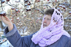 Elderly woman in lilac knitted scarf on her head Stock Images