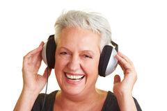 Elderly woman listening to music Stock Image