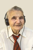 Elderly woman listening to music. Stock Photos