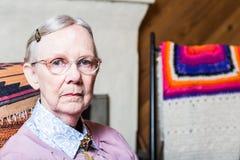 Elderly Woman in Livingroom Royalty Free Stock Image