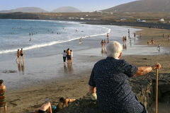 Elderly woman looking at the beach. Royalty Free Stock Photos