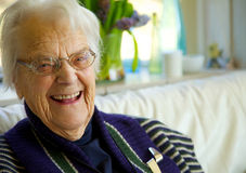 Elderly woman looking at the camera and smiling Royalty Free Stock Images